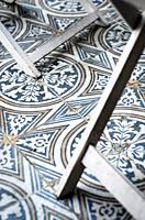 traditional design old rustic floor tiles detail in seville andalucia cafe.
