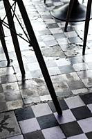 traditional design old rustic floor tiles detail in trendy Ibiza cafe.