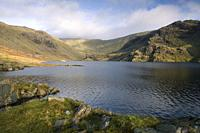 The dam of Seathwaite Tarn reservoir with Swirl How beyond in the Lake District National Park, Cumbria, England.
