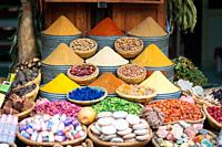 Variety of spices and herbs on market.