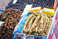 Fruit stall selling dried figs in a local market in Marrakech.