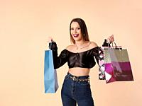 Beautiful young woman with shopping bags and cheerful fitness.