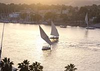 Feluccas on the river Nile at sunset, Aswan, Egypt.