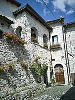 Rural homes decorated with potted flowers in the historical centre of Opi. Province of l'Aquila. Abruzzo. Italy.