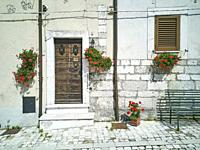 Rural home decorated with potted flowers in the historical centre of Opi. Province of l'Aquila. Abruzzo. Italy.