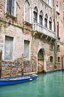 The facade of an old Venetian Gothic-style palace facing Rio De San Zan Degolà. Santa Croce Quarter. Venice. Veneto. Italy.