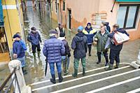 "Venice, Italy - November 24, 2019: the Mayor of Venezia Mr. Luigi Brugnaro talk with citizens in Fondamenta S. Giuseppe during the high tide """"acqua a..."