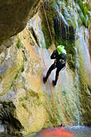 Canyoneering Los Meses Canyon in Pyrenees, Canfranc Valley, Huesca Province in Spain.