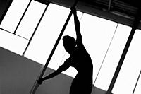 A young Colombian pole dancer spins around the pole during a pole dance training session in a gym in Bogotá, Colombia, 24 October 2019. Pole dance, a ...