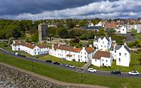 Aerial view whitewashed houses on Pan Ha ( Pan Haugh) and St Serf's Church at Dysart conservation village in Fife, Scotland ,UK.