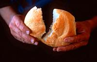 hands breaking bread, New Mexico.
