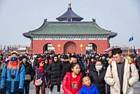 Tourists on Danbi Bridge in Temple of Heaven in Beijing, China - view with roof of Hall of Prayer for Good Harvests.