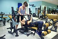 Two friends working out together in the gym