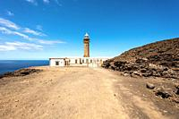 Beautiful view of famous El Faro de Punta Orchilla lighthouse with red volcanic scenery and wide open sea on a sunny day, El Hierro, Canary Islands, S...
