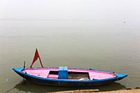 A tour boat on the banks of the Ganges River in Varanasi, India.