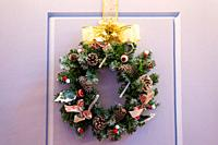 Beautiful christmas garland hang at door.