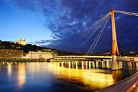 Footbridge, courthouse and basilica at Lyon city with citylights, France.
