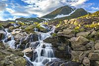 Waterfall with mountains in background with snow on them, evening light with nice colored sky, Gällivare county, Stora sjöfallet nationalpark, Swedish...