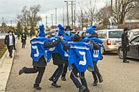 Southfield, Michigan - Boys dance as sars line up for a Car Top Menorah Parade on the fourth night of Chanukah.
