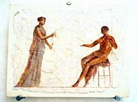 Fragment of a fresco depicting aman and a woman - imperial age- National Roman Museum - The Baths of Diocletian - Rome, Italy.