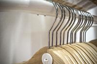 Empty wooden hangers. Selective focus.