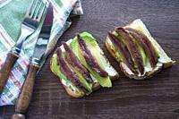 Spreadable cheese with avocado and anchovies.