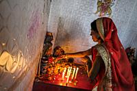 Siliguri, India - November 2020: Woman making offering at the Sashan Kali Temple in Siliguri on November 7, 2020 in West Bengala, India.