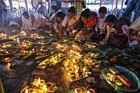 Hajo, India - November 2020: Women making offerings at the Hayagriva Madhava Temple in Hajo on November 12, 2020 in Assam, India.