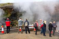 tourists at hot waterspring at Deildartunguhver at Iceland