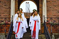 Stockholm, Sweden A school group in Liljeholmen performs a traditional Santa Lucia celebration with song on the steps of school.