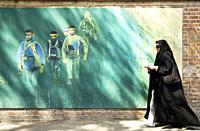 veiled woman in teheran iran street.
