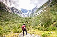 Hiking to Brenndals-breen Glacier, National Park of Jostedalsbreen, Vestland, Norway.