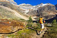 Hiker on the Yukness Ledges Trail at Lake Oesa, Yoho National Park, British Columbia, Canada.