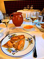 Fried aubergine with Romesco sauce in a typical restaurant. Madrid, Spain.