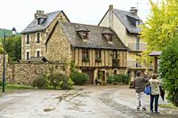 Sainte-Eulalie-d'Olt South of France, Aveyron Occitania on September 24, 2020 nice view of the antique medieval stone buildings at The banks of Lot ri...