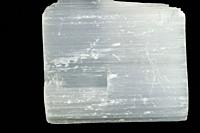 Milk quartz, cut out on a black background.