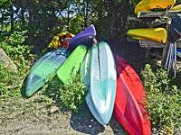 Beached. Kayaks out of the water.