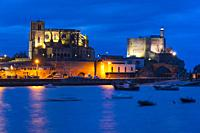 Castro Urdiales old town at dusk, with Santa Ana Church and Castillo Lighthouse, Cantabria, Spain, Europe.