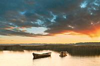 Wooden Rowing Fishing Boats In Beautiful Summer Sunset On Lake. Nature Of Belarus.