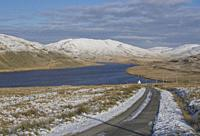 Recervoir surrounded by snow in the winter in the hills in Ceredigion,Wales,UK.