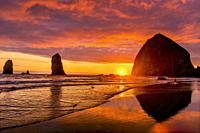 Colorful Sunset Birds Haystack Rock Sea Stacks Canon Beach Clatsap County Oregon. Orginally discovered by Clark of Lewis Clark in 1805.