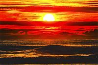 Sun Colorful Blue Red Orange Sunset Pacific Ocean Coastline Canon Beach Clatsap County Oregon. Amazing Sunsets at Canon Beach.