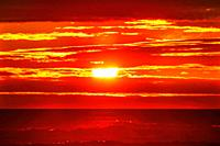 Sun Colorful Red Orange Sunset Pacific Ocean Coastline Canon Beach Clatsap County Oregon. Amazing Sunsets at Canon Beach.