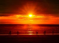 Colorful Red Orange Sunset Tourists Pacific Ocean Coastline Canon Beach Clatsap County Oregon. Amazing Sunsets at Canon Beach.