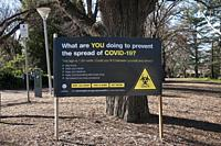 Cautionary signposting in suburban parks during the COVID-19 pandemic emergency in Melbourne, Victoria, Australia.