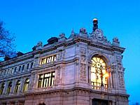 Facade of Banco de España, night view. Plaza de Cibeles, Madrid, Spain.