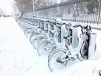 Snow covered BiciMad parking. Menendez Pelayo Avenue, Madrid, Spain.
