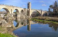 Fluvia riverside with medieval bridge at bottom, Besalu. Garrotxa, Girona, Catalonia, Spain.