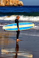 Europe, Portugal, Southern Portugal , Algarve region , Faro district , Sagres, Mareta beach - Praia da Mareta , single male surfer with surfboard obse...