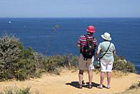 Atlantic coast in Lagos seen from Ponta da Piedade, mature couple admiring view from Ponta da Piedade, Lagos, Algarve, Portugal, Europe